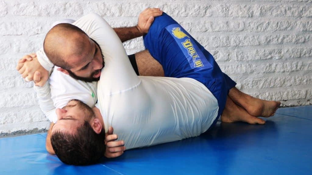 Two Jiu Jitsu fighters training.